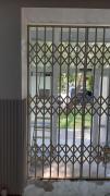 Sliding metal grilles on the door, windows, showcases Nikolaev